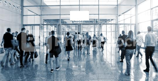 blurred Trade Show visitors walking to a entrance  : Stock Photo or Stock Video Download rcfotostock photos, images and assets rcfotostock | RC-Photo-Stock.:
