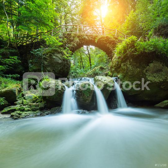 Bridge over a fairy tale waterfall  : Stock Photo or Stock Video Download rcfotostock photos, images and assets rcfotostock | RC-Photo-Stock.: