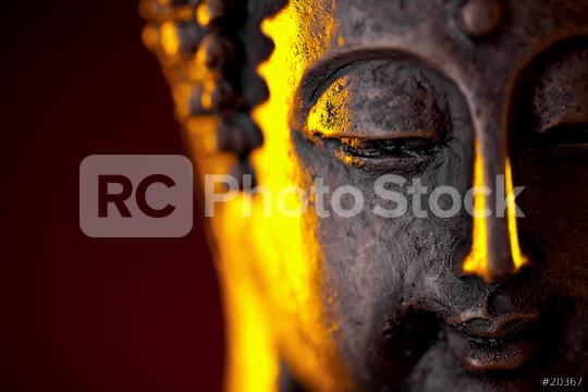Buddha statue head with glow against black background, with copy space  : Stock Photo or Stock Video Download rcfotostock photos, images and assets rcfotostock | RC-Photo-Stock.: