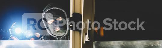 Burglar at night with flashlight at window of the house, with copy space, banner size  : Stock Photo or Stock Video Download rcfotostock photos, images and assets rcfotostock | RC-Photo-Stock.: