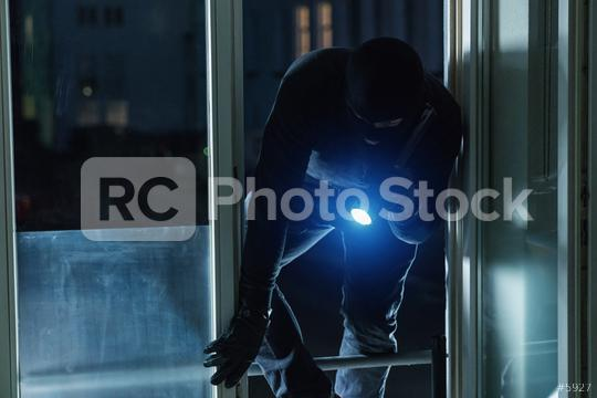 Burglar breaking and entering a house window at night  : Stock Photo or Stock Video Download rcfotostock photos, images and assets rcfotostock | RC-Photo-Stock.: