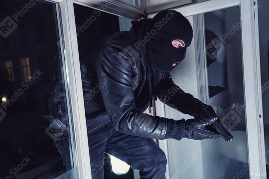 Burglar entering a victim