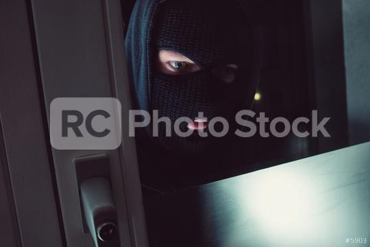 Burglar in a mask looking into the House at night  : Stock Photo or Stock Video Download rcfotostock photos, images and assets rcfotostock | RC-Photo-Stock.: