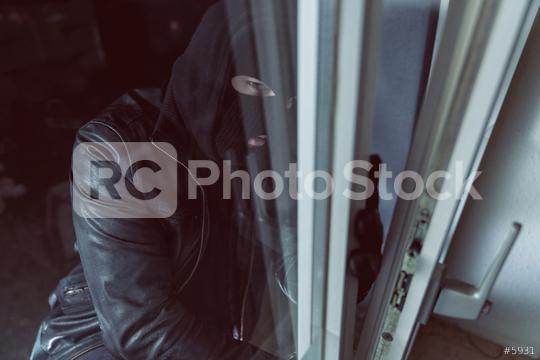 Burglar looking to a open window of a house at night  : Stock Photo or Stock Video Download rcfotostock photos, images and assets rcfotostock | RC-Photo-Stock.: