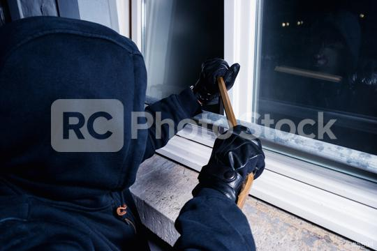 burglar opens a window with a crowbar at night  : Stock Photo or Stock Video Download rcfotostock photos, images and assets rcfotostock   RC-Photo-Stock.:
