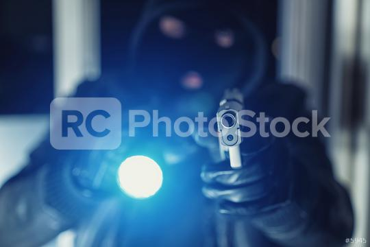 Burglar or a thief holding a gun with flashlight in a house  : Stock Photo or Stock Video Download rcfotostock photos, images and assets rcfotostock | RC-Photo-Stock.: