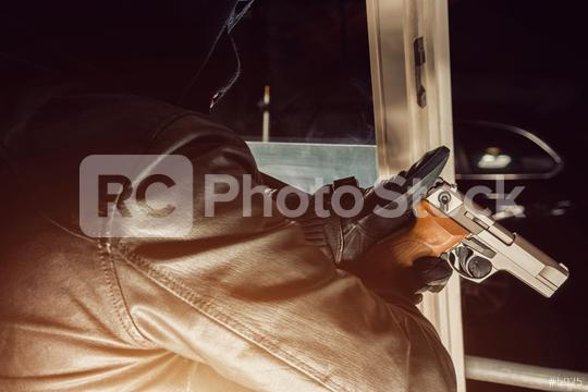 burglar pointing a gun out of the window   : Stock Photo or Stock Video Download rcfotostock photos, images and assets rcfotostock | RC-Photo-Stock.: