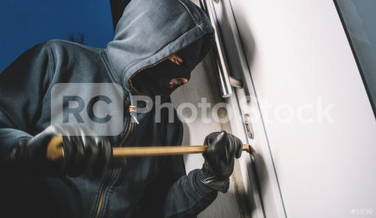 Burglar pries up the door and enters the house  : Stock Photo or Stock Video Download rcfotostock photos, images and assets rcfotostock   RC-Photo-Stock.: