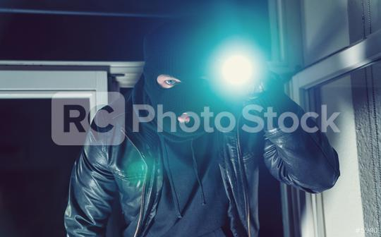 Burglar trying to break into a house with a flashlight  : Stock Photo or Stock Video Download rcfotostock photos, images and assets rcfotostock | RC-Photo-Stock.:
