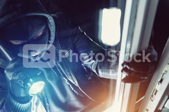 Burglar using flashlight and leather coat to breaking in a house at night  : Stock Photo or Stock Video Download rcfotostock photos, images and assets rcfotostock | RC-Photo-Stock.:
