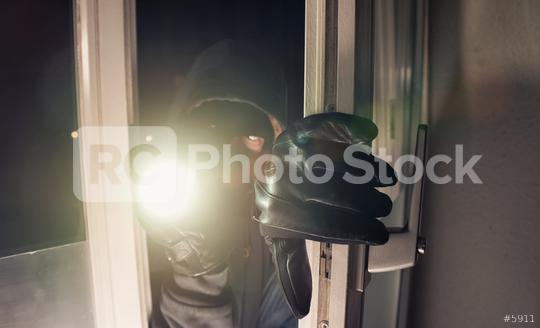Burglar using flashlight to break into a house at night   : Stock Photo or Stock Video Download rcfotostock photos, images and assets rcfotostock | RC-Photo-Stock.: