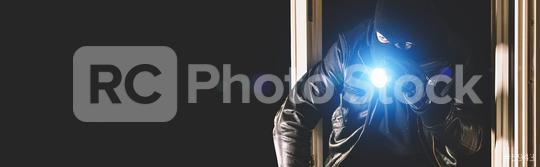 Burglar with crowbar and flashlight in the window of a house, with copy space, banner size  : Stock Photo or Stock Video Download rcfotostock photos, images and assets rcfotostock | RC-Photo-Stock.: