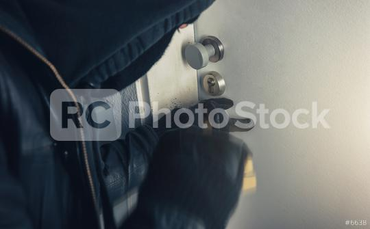 burglar with crowbar breaking in to a house door  : Stock Photo or Stock Video Download rcfotostock photos, images and assets rcfotostock | RC-Photo-Stock.: