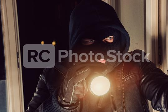 Burglar with flashlight looking through the House  : Stock Photo or Stock Video Download rcfotostock photos, images and assets rcfotostock | RC-Photo-Stock.: