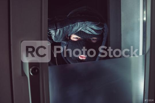 Burglar with looking through the window at night  : Stock Photo or Stock Video Download rcfotostock photos, images and assets rcfotostock | RC-Photo-Stock.: