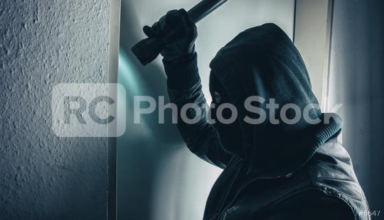 burglar with torch breaking and entering into a victim