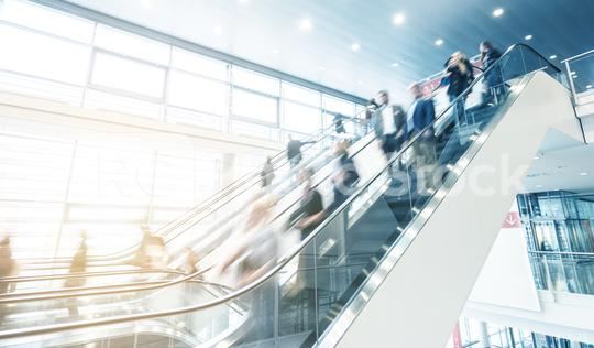 business people at a moving escalator  : Stock Photo or Stock Video Download rcfotostock photos, images and assets rcfotostock | RC-Photo-Stock.: