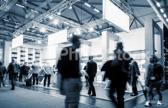 business people walking at a trade show booth at a public event exhibition hall, with banner and copy space for individual text  : Stock Photo or Stock Video Download rcfotostock photos, images and assets rcfotostock   RC-Photo-Stock.:
