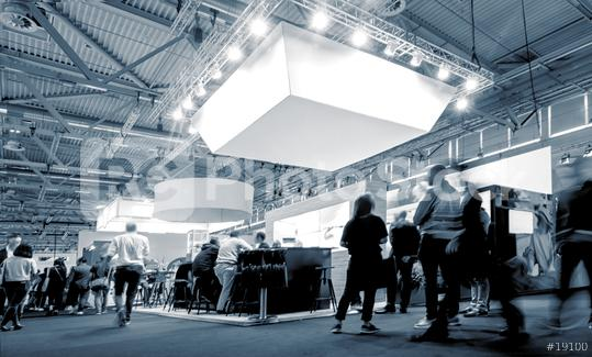 business people walking between trade show booths at a public event exhibition hall  : Stock Photo or Stock Video Download rcfotostock photos, images and assets rcfotostock | RC-Photo-Stock.:
