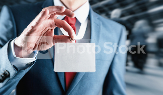 Businessman at an exhibition or tradeshow showing a blank security identity name card on a lanyard  : Stock Photo or Stock Video Download rcfotostock photos, images and assets rcfotostock   RC-Photo-Stock.: