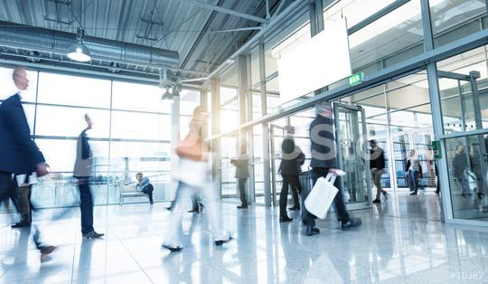 businessman goes along a corridor at a Tradeshow  : Stock Photo or Stock Video Download rcfotostock photos, images and assets rcfotostock | RC-Photo-Stock.: