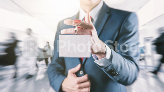 Businessman holding a exhibition identity name card  : Stock Photo or Stock Video Download rcfotostock photos, images and assets rcfotostock | RC-Photo-Stock.: