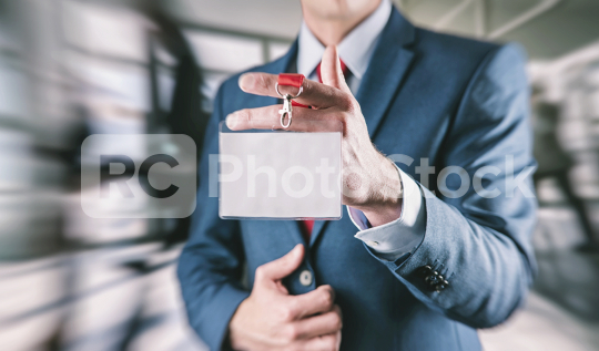 Businessman holding a Trade Fair entrance card on a lanyard  : Stock Photo or Stock Video Download rcfotostock photos, images and assets rcfotostock | RC-Photo-Stock.: