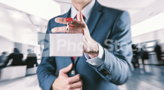 Businessman showing a blank identity name card at a exhibition  : Stock Photo or Stock Video Download rcfotostock photos, images and assets rcfotostock | RC-Photo-Stock.: