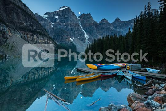 Canoes on a jetty at Moraine lake, Banff national park in the Rocky Mountains at night with moon, Alberta, Canada  : Stock Photo or Stock Video Download rcfotostock photos, images and assets rcfotostock | RC-Photo-Stock.: