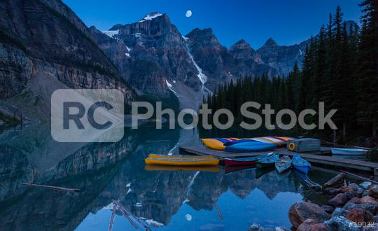 Canoes on a jetty at Moraine lake, Banff national park in the Rocky Mountains at night with moon, Alberta, Canada  : Stock Photo or Stock Video Download rcfotostock photos, images and assets rcfotostock   RC-Photo-Stock.:
