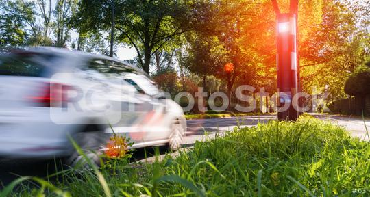 car drives into a radar trap, safe road traffic concept image  : Stock Photo or Stock Video Download rcfotostock photos, images and assets rcfotostock | RC-Photo-Stock.: