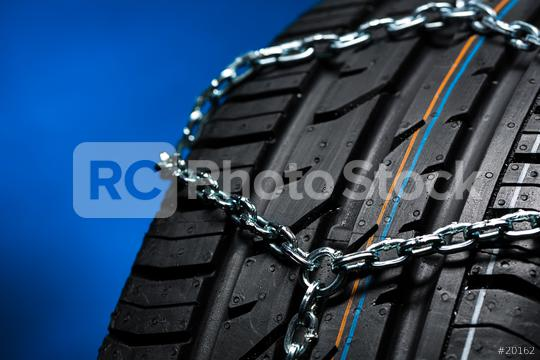 Car tyre with snow chain in the winter with blue background  : Stock Photo or Stock Video Download rcfotostock photos, images and assets rcfotostock | RC-Photo-Stock.: