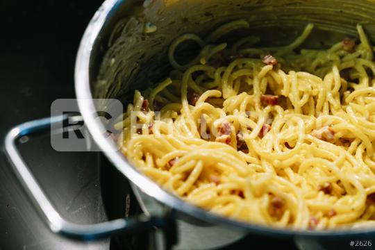 Carbonara pasta, spaghetti with pancetta, egg, hard parmesan cheese and cream sauce in a silver pot  : Stock Photo or Stock Video Download rcfotostock photos, images and assets rcfotostock   RC-Photo-Stock.: