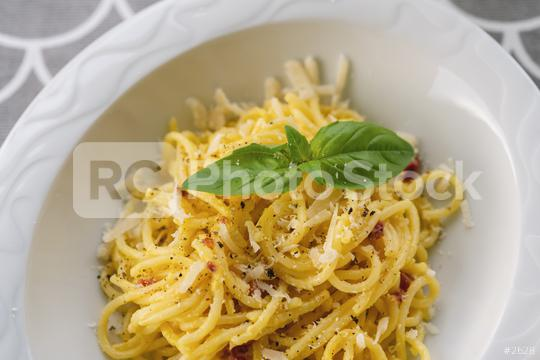 Carbonara pasta, spaghetti with pancetta, egg, hard parmesan cheese and cream sauce. Traditional italian cuisine. Pasta alla carbonara  : Stock Photo or Stock Video Download rcfotostock photos, images and assets rcfotostock | RC-Photo-Stock.: