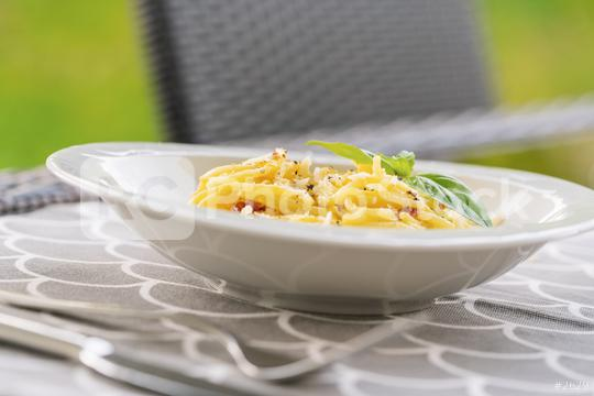 Carbonara pasta, spaghetti with pancetta, egg, hard parmesan cheese and cream sauce. on a table outside  : Stock Photo or Stock Video Download rcfotostock photos, images and assets rcfotostock   RC-Photo-Stock.: