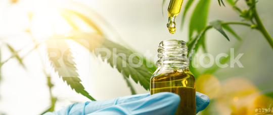 close up of droplet dosing a biological and ecological hemp plant herbal pharmaceutical cbd oil from a jar  : Stock Photo or Stock Video Download rcfotostock photos, images and assets rcfotostock | RC-Photo-Stock.: