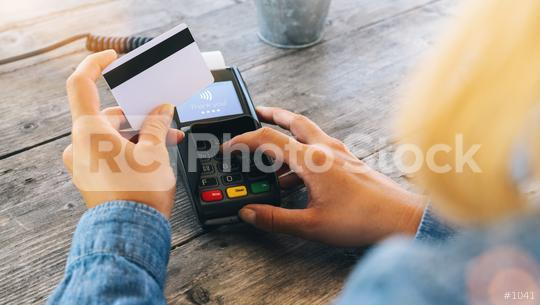 Close up of hand using credit card swiping machine to pay. Hand with creditcard swipe through terminal for payment in cafeteria. Woman entering credit card code in swipe machine.  : Stock Photo or Stock Video Download rcfotostock photos, images and assets rcfotostock   RC-Photo-Stock.: