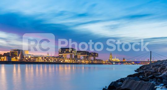 Cologne city panorama with cathedral and crane houses at sunset  : Stock Photo or Stock Video Download rcfotostock photos, images and assets rcfotostock | RC-Photo-Stock.:
