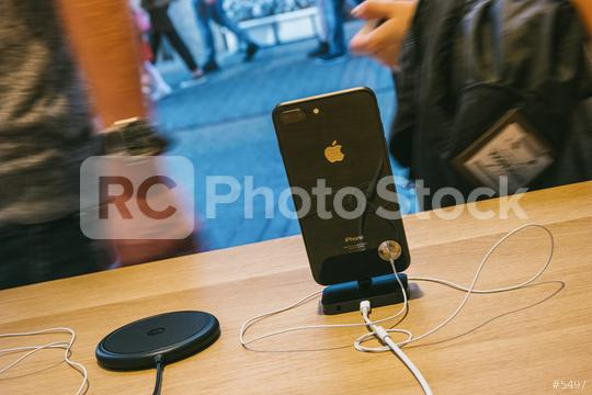 COLOGNE, GERMANY OCTOBER, 2017: presentation of the iPhone 8 and  Phone X in a Apple Store with reflection of street in glass facade with phones inside next to AirPower wireless charging.  : Stock Photo or Stock Video Download rcfotostock photos, images and assets rcfotostock   RC-Photo-Stock.: