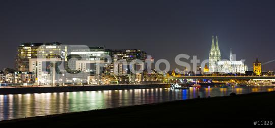 Cologne Skyline with Cathedral and crane houses at night  : Stock Photo or Stock Video Download rcfotostock photos, images and assets rcfotostock | RC-Photo-Stock.: