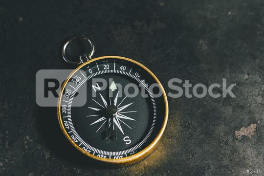 compass on a table concept for direction, travel, guidance or assistance  : Stock Photo or Stock Video Download rcfotostock photos, images and assets rcfotostock   RC-Photo-Stock.: