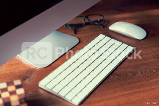 Computer on desktop in hipster workplace office - no people  : Stock Photo or Stock Video Download rcfotostock photos, images and assets rcfotostock   RC-Photo-Stock.: