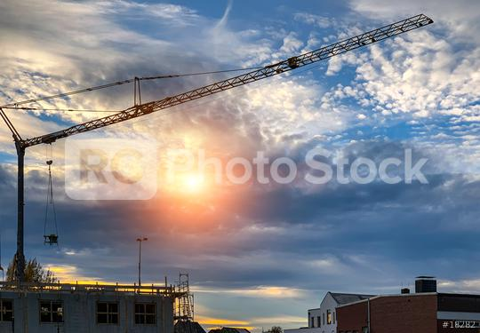 construction crane at sunset  : Stock Photo or Stock Video Download rcfotostock photos, images and assets rcfotostock   RC-Photo-Stock.: