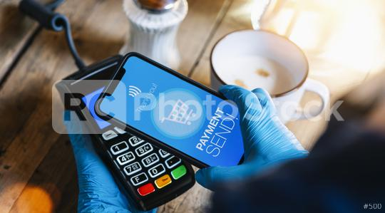 contact less payment on a mobile phone. Close up of a woman hand with gloves paying contactless with a smartphone screen application. Hand holding smart device to pay. Mockup cellphone screen.  : Stock Photo or Stock Video Download rcfotostock photos, images and assets rcfotostock   RC-Photo-Stock.: