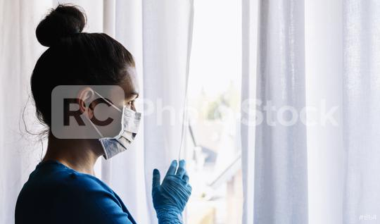 corona COVID-19 infection person looks looking out of window to the street - stay at home  : Stock Photo or Stock Video Download rcfotostock photos, images and assets rcfotostock | RC-Photo-Stock.: