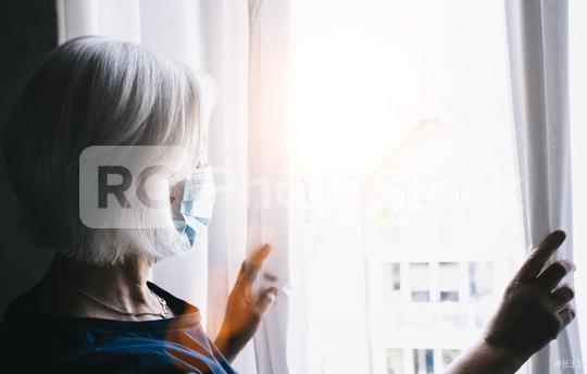 Coronavirus. Sick old woman of corona virus looking through the window and wearing mask protection and recovery from the illness in home. Quarantine. Patient isolated to prevent infection. Lockdown   : Stock Photo or Stock Video Download rcfotostock photos, images and assets rcfotostock | RC-Photo-Stock.:
