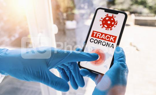 coronavirus tracker app on a mobile smartphone. Close up of woman tracking crowd of people in a smartphone screen application. Hand holding smart device. Mockup website. covid-19 corona virus tracker  : Stock Photo or Stock Video Download rcfotostock photos, images and assets rcfotostock | RC-Photo-Stock.: