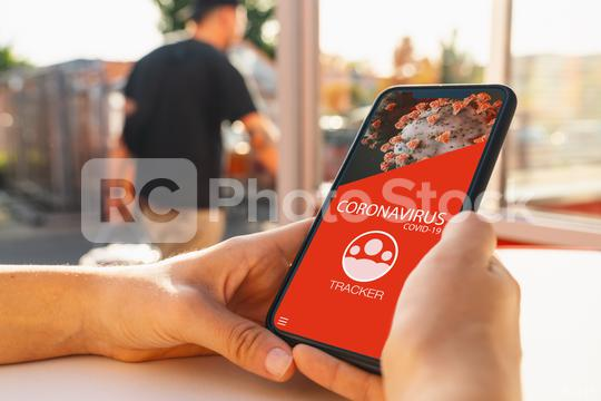 coronavirus tracking app on a mobile smartphone. Close up of woman tracking crowd of people in a smartphone screen application. Hand holding smart device. Mockup website. covid-19 corona virus tracker  : Stock Photo or Stock Video Download rcfotostock photos, images and assets rcfotostock | RC-Photo-Stock.: