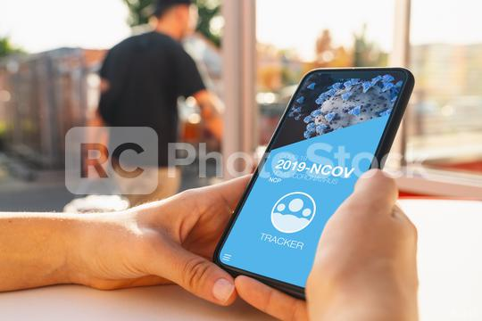 covid-19 pandemic tracking app on a mobile smartphone. Close up of woman tracking crowd of people in a smartphone screen application. Hand holding smart device. Mockup website. coronavirus corona  : Stock Photo or Stock Video Download rcfotostock photos, images and assets rcfotostock   RC-Photo-Stock.: