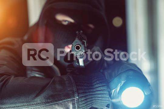 criminal Burglar looking and holding a gun with flashlight to entering a house at night  : Stock Photo or Stock Video Download rcfotostock photos, images and assets rcfotostock | RC-Photo-Stock.: